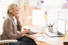 Casual designer working at her desk Royalty Free Stock Photos