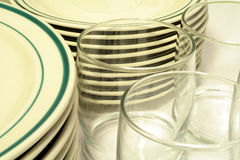 Casual Dinnerware and Glasses. This is a close up image of casual dinnerware and drinking glasses royalty free stock photography