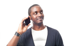 Casual dressed black man at the phone. Stock Photos