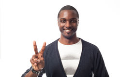 Casual dressed black man showing peace sign. Stock Image