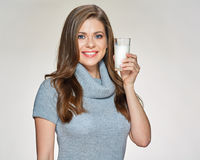 Casual dressed woman wearing gray warm dress drink milk. Smiling female model isolated portrait Stock Photography