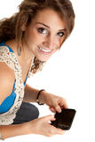 Casual Dressed Young Student Texting on Cell Phone Royalty Free Stock Photography
