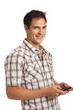 Casual Dressed Young Student Texting on Cell Phone Stock Image