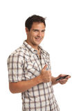 Casual Dressed Young Student Texting on Cell Phone Royalty Free Stock Photos