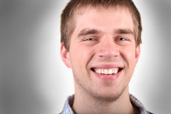 Casual dude smiling. Happy guy next door kind of dude with a wide smile royalty free stock photo