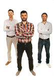 Casual executives with arms folded. Casual three executives men with arms folded isolated on white background stock image