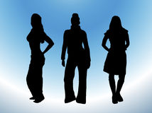 Casual Fashion. Silhouette of three models in casual wear on white and blue background Stock Photos