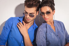 Casual fashion couple looking down Stock Photo