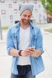 Casual fashion guy taking a walk in the city Royalty Free Stock Photography