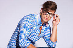 Casual fashion male model holding his glasses Royalty Free Stock Photography