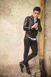 Casual fashion man leaning on a old pipe Stock Images