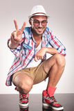 Casual fashion man showing the victory gesture. Stock Photo