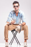 Casual fashion man sitting on a stool Royalty Free Stock Photography