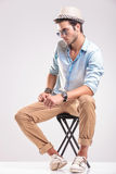 Casual fashion man sitting on a stool Stock Photo