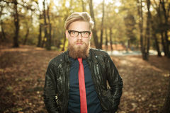 Casual fashion man walking in the park Stock Image