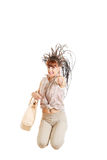Casual fashion woman with bag jumping happy Royalty Free Stock Photos