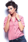 Casual fashion young woman pulling her collar Royalty Free Stock Images