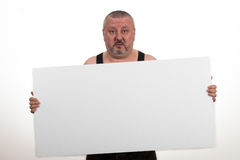 Casual fat man holding an blank paper over a white background Stock Photography
