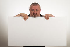 Casual fat man holding an blank paper over a white background Stock Image