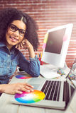 Casual female designer using laptop Stock Images