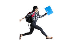 Casual female student running. Isolated on white background Royalty Free Stock Photos