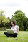 Casual Female Using Laptop Stock Image