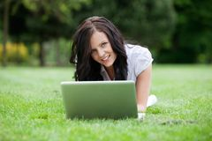 Casual Female Using Laptop in Park Royalty Free Stock Image