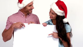 Casual festive couple pointing to card stock video footage