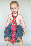 Casual Friday. Image of cute toddler wearing jeans and a tie Stock Images