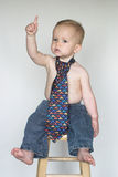Casual Friday. Image of cute toddler wearing jeans and a tie Royalty Free Stock Photos