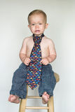 Casual Friday. Image of cute toddler wearing jeans and a tie Royalty Free Stock Images