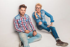 Casual friends having a break and sit on the floor Royalty Free Stock Images