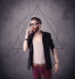 Casual funny male using mobile phone Royalty Free Stock Photo