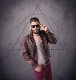 Casual funny male using mobile phone Royalty Free Stock Photos