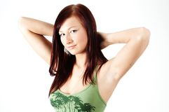 Casual girl with arms behind her head Royalty Free Stock Image
