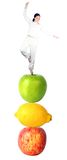 Casual girl balancing on fruits - balanced diet Stock Images