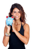 Casual girl with a blue piggy-bank. Isolated on a white background stock photography