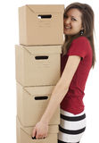 Casual girl carrying cardboard boxes. Young woman carrying cardboard boxes, white background Stock Image