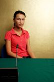 Casual girl at conference on gold background Royalty Free Stock Images