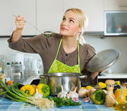 Casual girl cooking with vegetables. Portrait of casual girl cooking with vegetables Stock Image