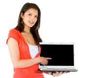 Casual girl displaying laptop Royalty Free Stock Image