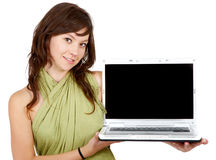 Casual girl displaying a laptop computer Royalty Free Stock Photo