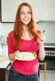 Casual  girl eating boiled potatoes Royalty Free Stock Photo