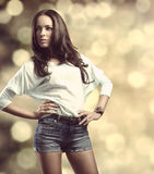 Casual girl in fashion pose bokeh background Royalty Free Stock Photography