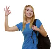 Casual girl female student with bag backpack showing OK isolated Stock Photos