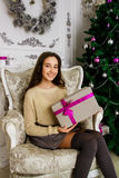 Casual girl with a gift Royalty Free Stock Image