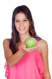 Casual girl with a green apple Royalty Free Stock Photo