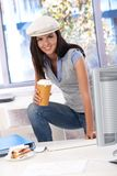 Casual girl having coffee-break at desk Royalty Free Stock Photo
