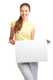 Casual girl holding a blank signboard Royalty Free Stock Photos