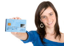 Casual girl holding a credit card Royalty Free Stock Image